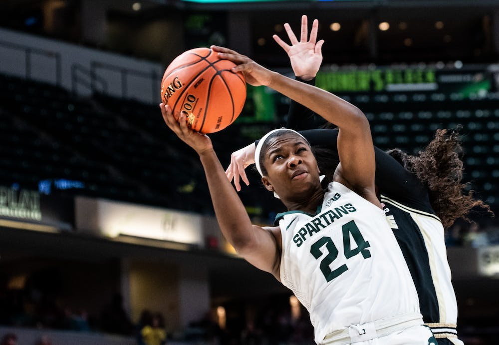 <p>Junior guard Nia Clouden (24) is fouled as she shoots during the game against Purdue at Bankers Life Fieldhouse in Indianapolis March 5, 2020.</p>