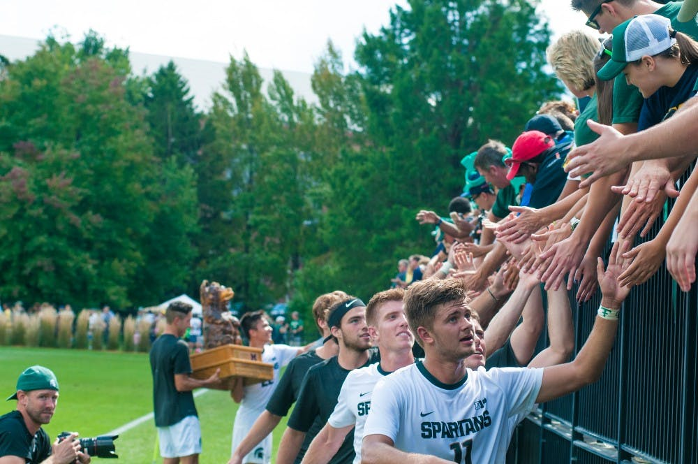 Sophomore forward Ryan Sierakowski (11) leads the team in a line treating the audience on Sept. 18, 2016 at DeMartin Stadium at Old College Field. The Spartans defeated the Michigan Wolverines, 1-0.