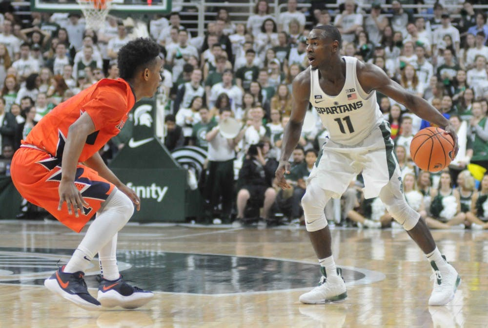 <p>Senior guard Lourawls Nairn Jr. (11) goes against Illinois' guard Trent Frazier (1) during the first half of the men's basketball game against Illinois on Feb. 20, 2018 at Breslin Center. The Spartan's led the first half, 38-35. (Annie Barker | The State News)</p>