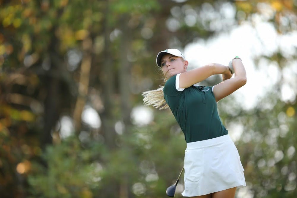 <p>Senior Sarah Burnham looks at her shot at the Mary Fossum Invitational in East Lansing in fall 2017. (Photo courtesy: MSU Athletic Communications)</p>