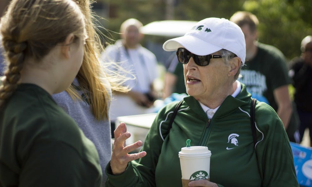 <p>MSU President Lou Anna K. Simon helps incoming students as they move in on Aug. 27, 2017 at Wonders Hall. President Simon spoke with many of the new students and gave them words of advice on being a Spartan.&nbsp;</p>