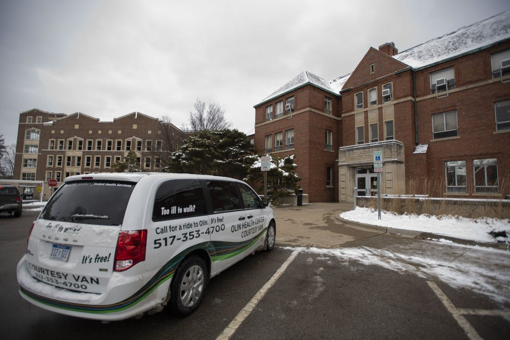 A courtesy van parked outside Olin Health Center on February 27, 2020.
