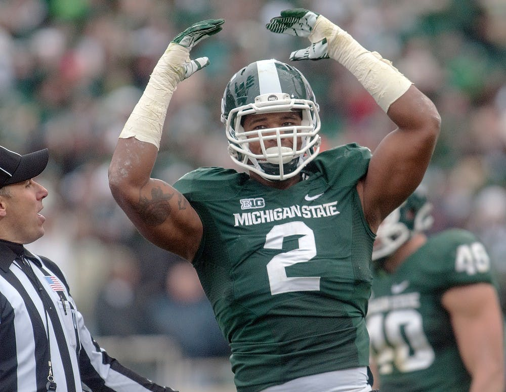<p>Junior defensive end William Gholston pumps up the crowd Nov. 3, 2012, at Spartan Stadium. Gholston was a member of the Superbowl LV winning Tampa Bay Buccaneers, who defeated the Kansas City Chiefs on Feb. 7, 31-9 to become the first team to pay in and win a Superbowl at their home stadium. (Adam Toolin/The State News)</p>