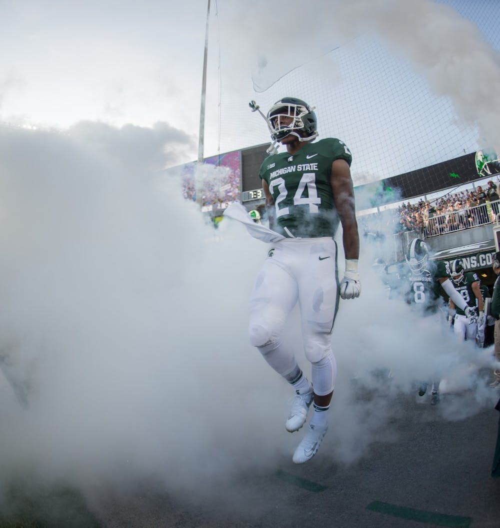 <p>Freshman running back Elijah Collins (24) runs out of the tunnel prior to the game against Utah State on Aug. 31, 2018 at Spartan Stadium. </p>