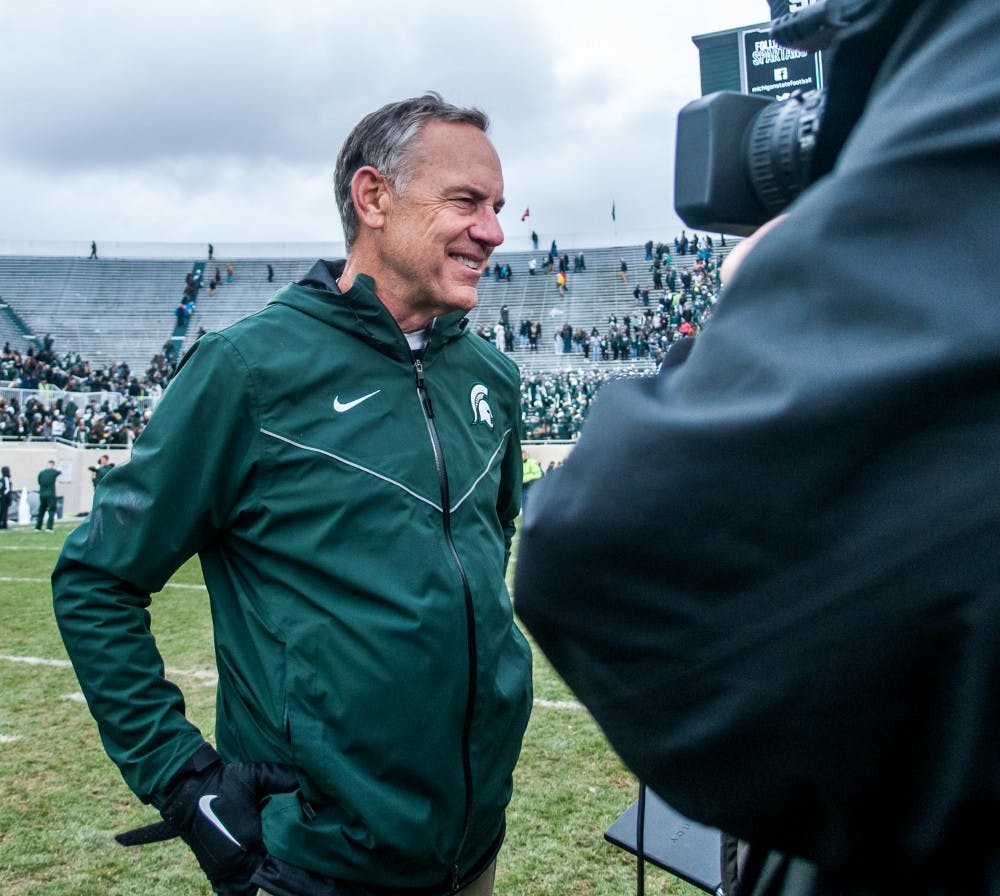Head coach Mark Dantonio smiles while being interviewed after the game against Purdue on Oct. 27, 2018 at Spartan Stadium. The Spartans defeated the Boilermakers 23-13.