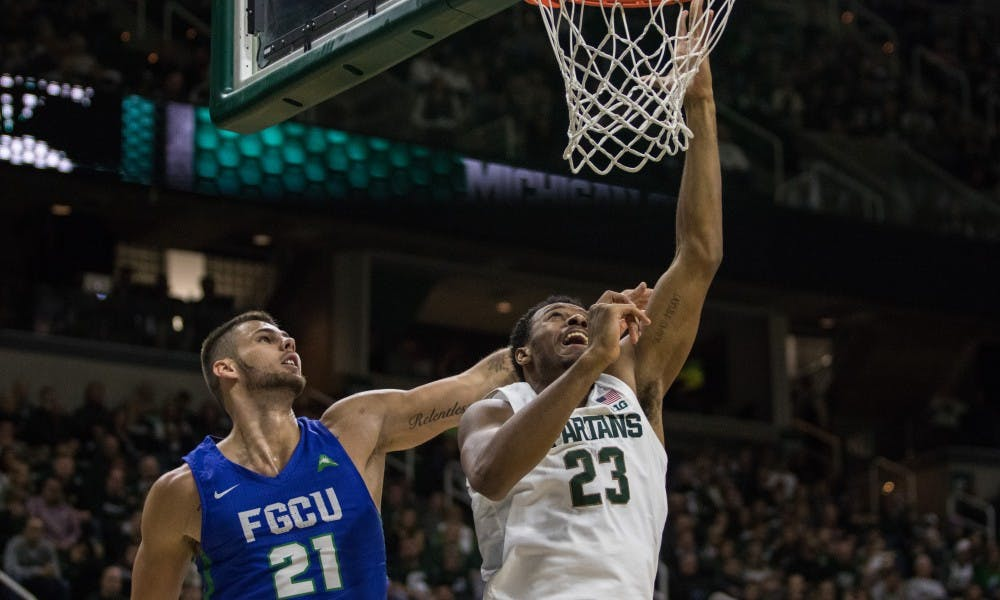 Sophomore forward Xavier Tillman (23) makes a basket during the game against Florida Gulf Coast University at Breslin Center on Nov. 11, 2018. The Spartans defeated the Eagles, 106-82.