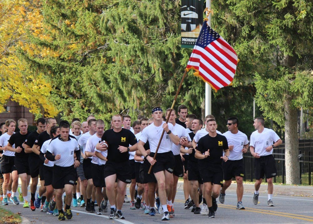 <p>ROTC cadets run in Alex's Great State Race from U-M to MSU in 2016. Photo courtesy of MSU Resource Center for Person with Disabilities Facebook page.&nbsp;</p>