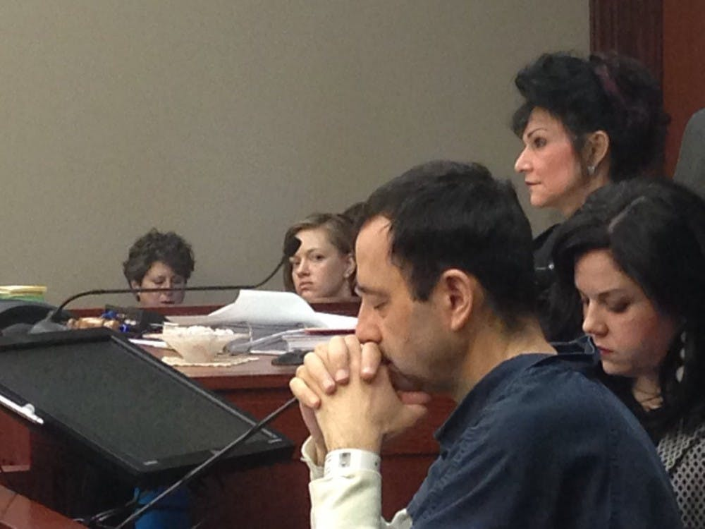 Larry Nassar, Judge Rosemarie Aquilina (above) and Shannon Smith, one of Nassar's attorneys, are seated at the podium during Nassar's sentencing hearing Tuesday.