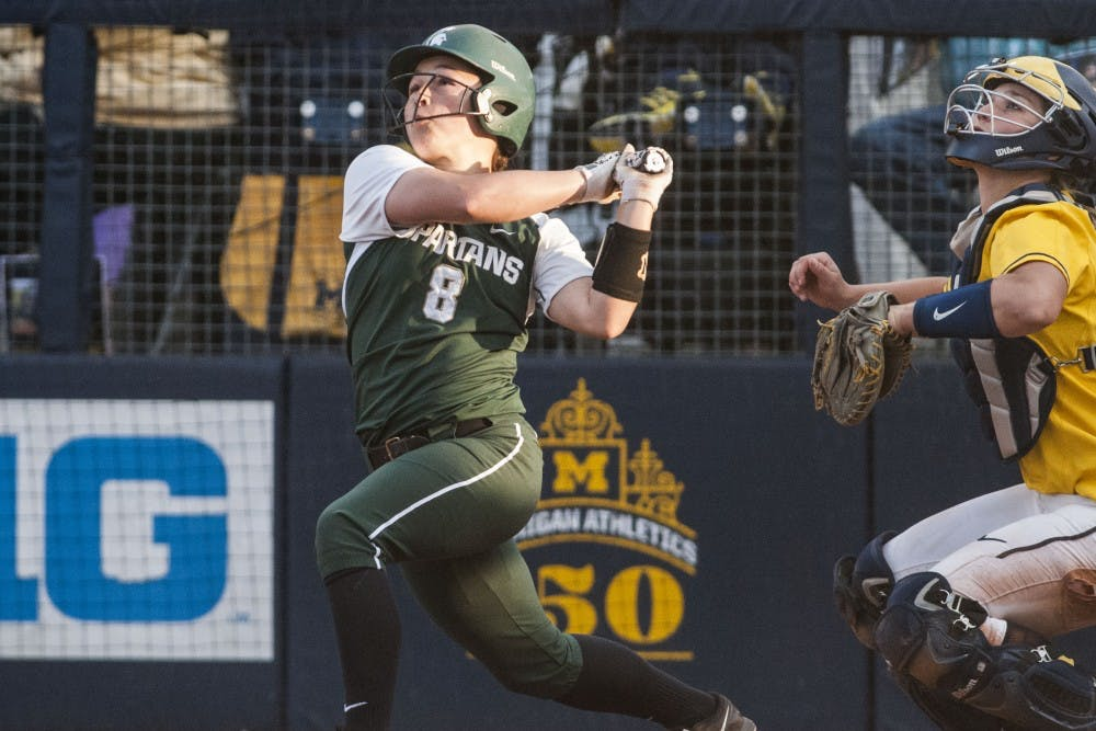 <p>Sophomore utility player Kaitlyn Eveland (8) swings the bat during the game against University of Michigan on April 18, 2017 Wilpon Baseball and Softball Complex in Ann Arbor. The Spartans were defeated by the Wolverines, 3-1.</p>