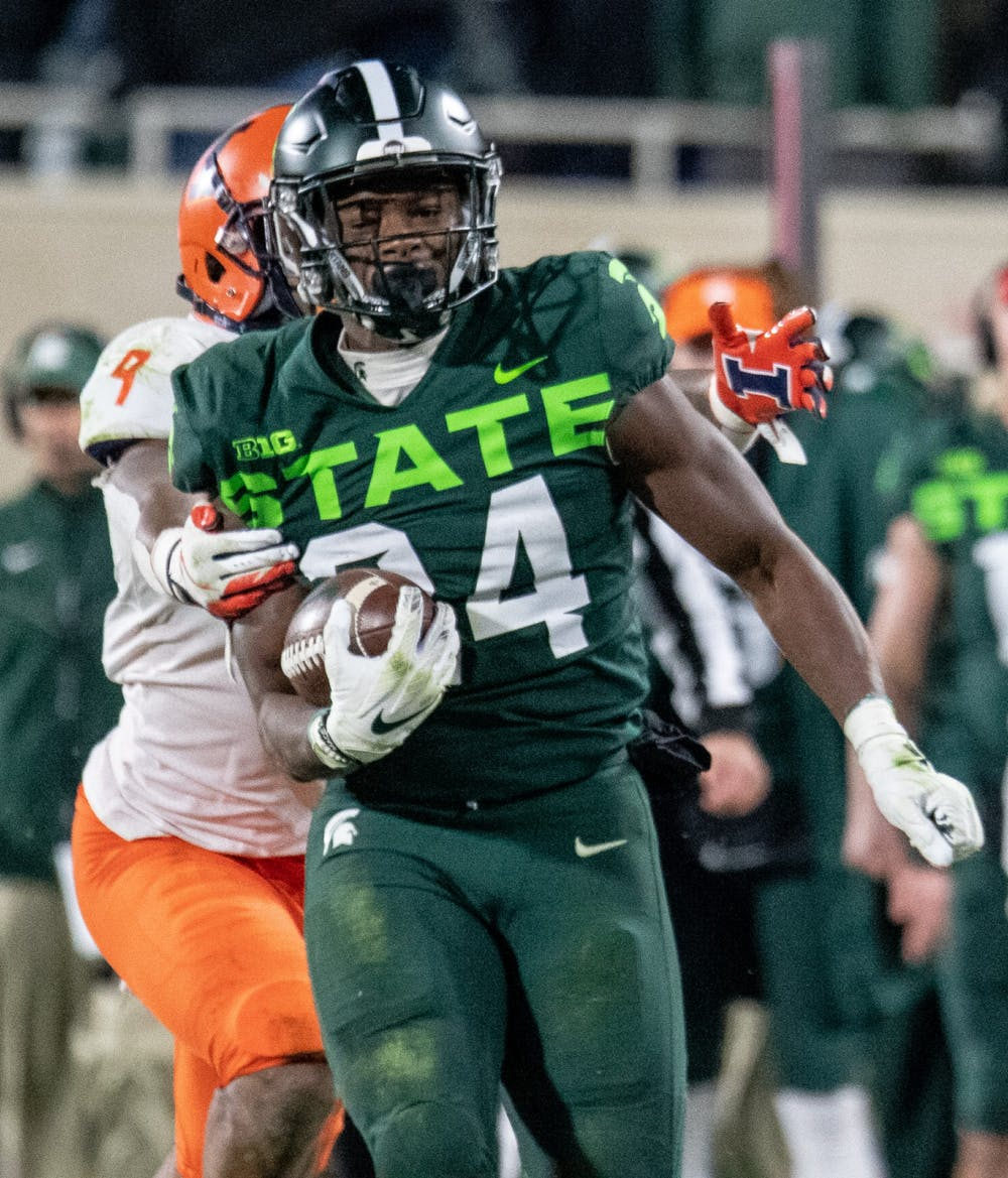 <p>Redshirt freshman Elijah Collins (24) is brought down on a long run during the game against Illinois on Nov. 9, 2019, at Spartan Stadium. The Spartans fell to the Fighting Illini, 37-34.</p>