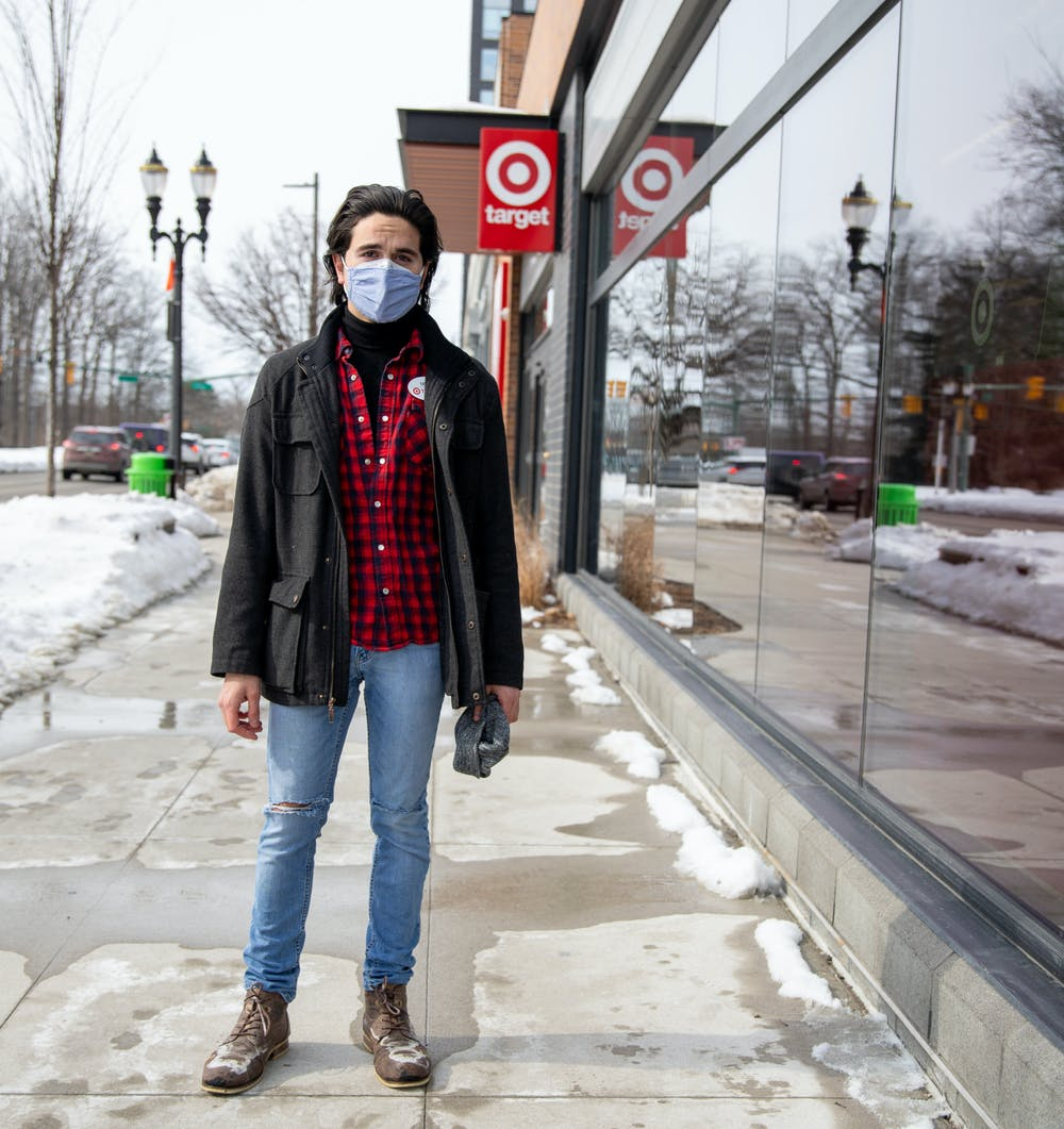 Feb. 21- East Lansing- Mitchell Page standing outside of the Target he works at on Grand River.