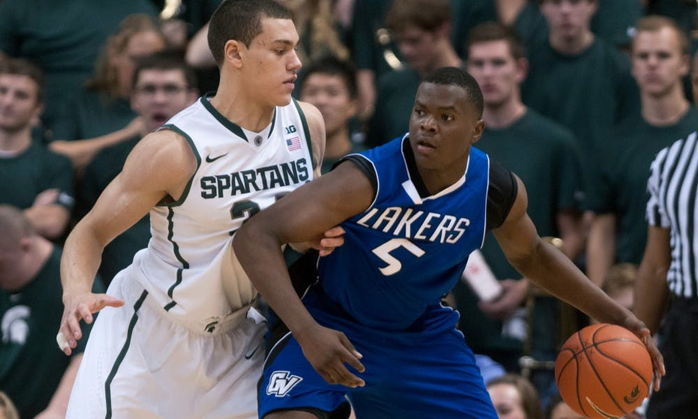 Freshman forward Gavin Schilling guards Grand Valley State forward Trevin Alexander on Oct. 29, 2013, during the game at Breslin Center. MSU defeated the Lakers, 101-52. Julia Nagy/The State News