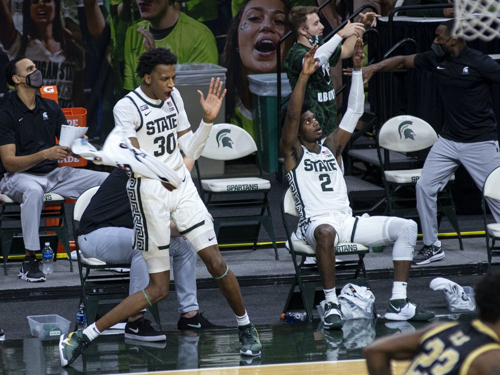 <p>Junior forward Marcus Bingham Jr. (30) celebrates his team scoring by dancing with a towel in the second half. The Spartans came back in the second half to end the game against the Broncos 79-61 on Dec. 6, 2020.</p>