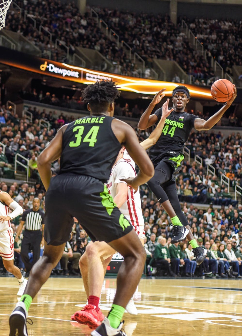 <p>Sophomore forward Gabe Brown (44) passes the ball during the game against Wisconsin at Breslin Center on Jan. 17. The Spartans lead the Badgers at the half, 35-20.</p>