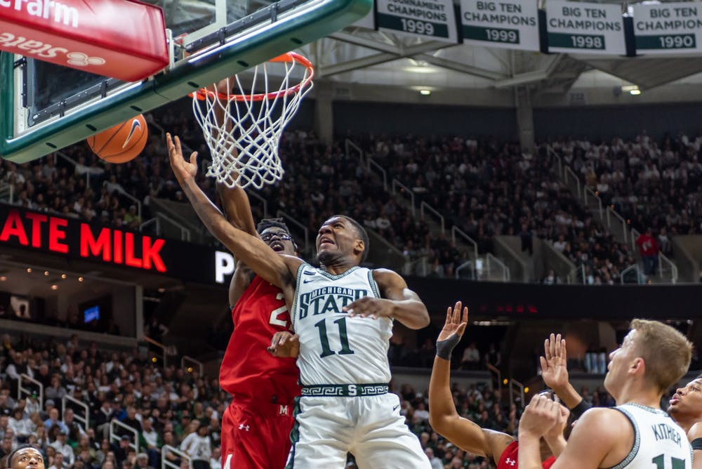 <p>Sophomore Aaron Henry (11) is fouled on a shot by Maryland's Jalen Smith (25). The Spartans fell to the Terrapins, 60-67, at the Breslin Student Events Center on Feb. 15, 2020. </p>