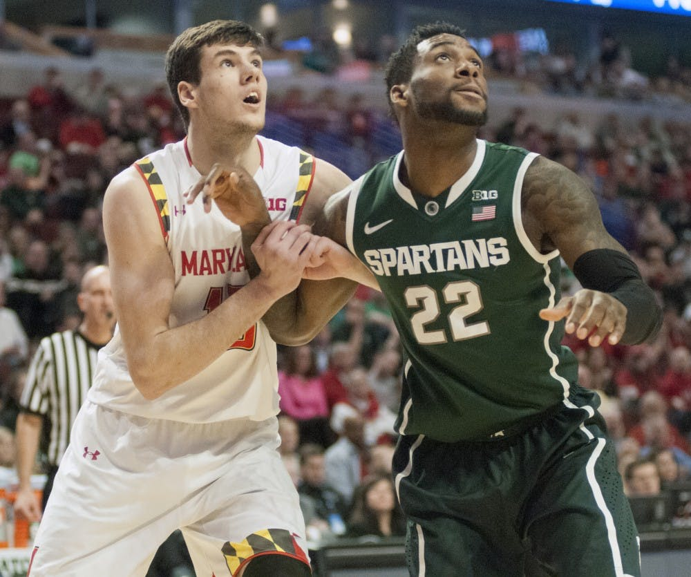 <p>Senior forward/guard Branden Dawson prepares for a rebound over Maryland freshman forward Michal Cekovsky Mar. 14, 2015, during the game against Maryland at the Big Ten Tournament at United Center in Chicago. The Spartans defeated the Terrapins, 62-58. Kelsey Feldpausch/The State News</p>