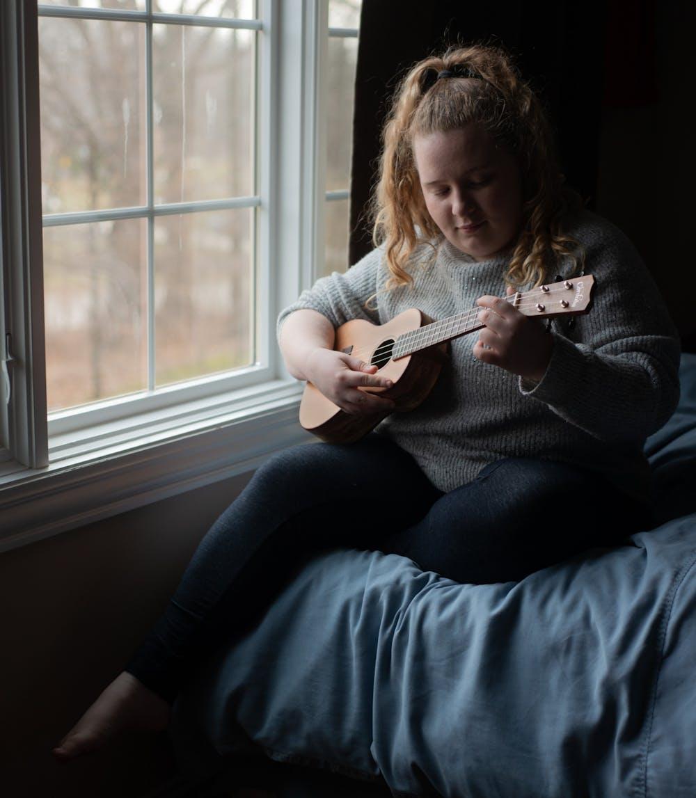 Kristina Katilius poses for a portrait with her ukulele during the coronavirus quarantine on March 24, 2020.