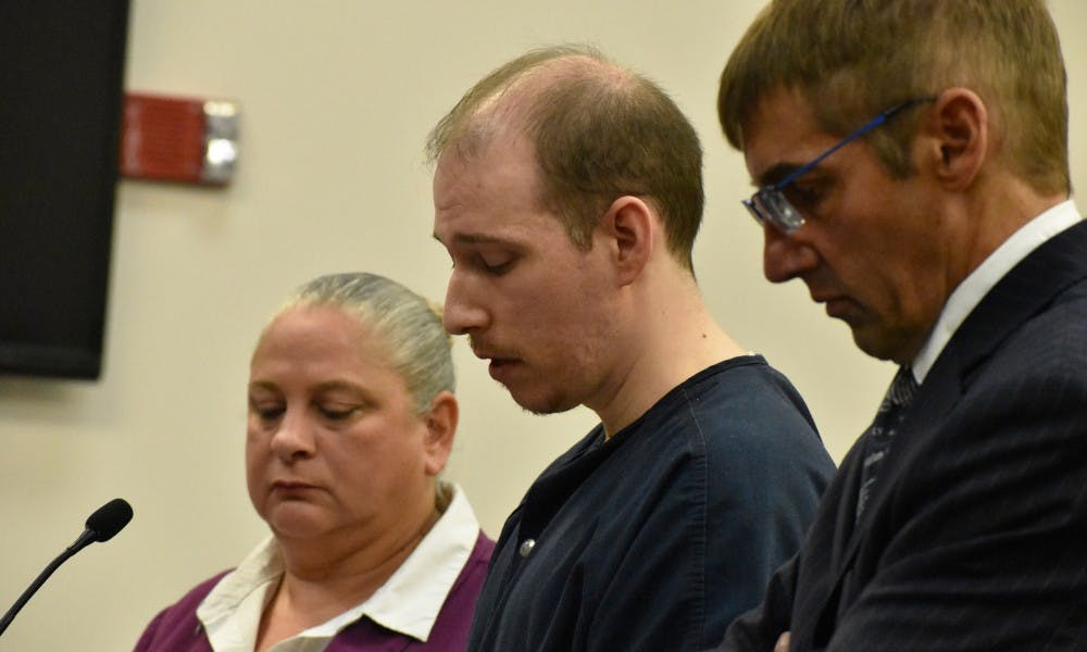 <p>Michael Phinn reads his testimony before the judge, which included apologies to his wife and son for behaving the way he did. Phinn&#x27;s trial took place in Ingham County on Sept. 18. </p>