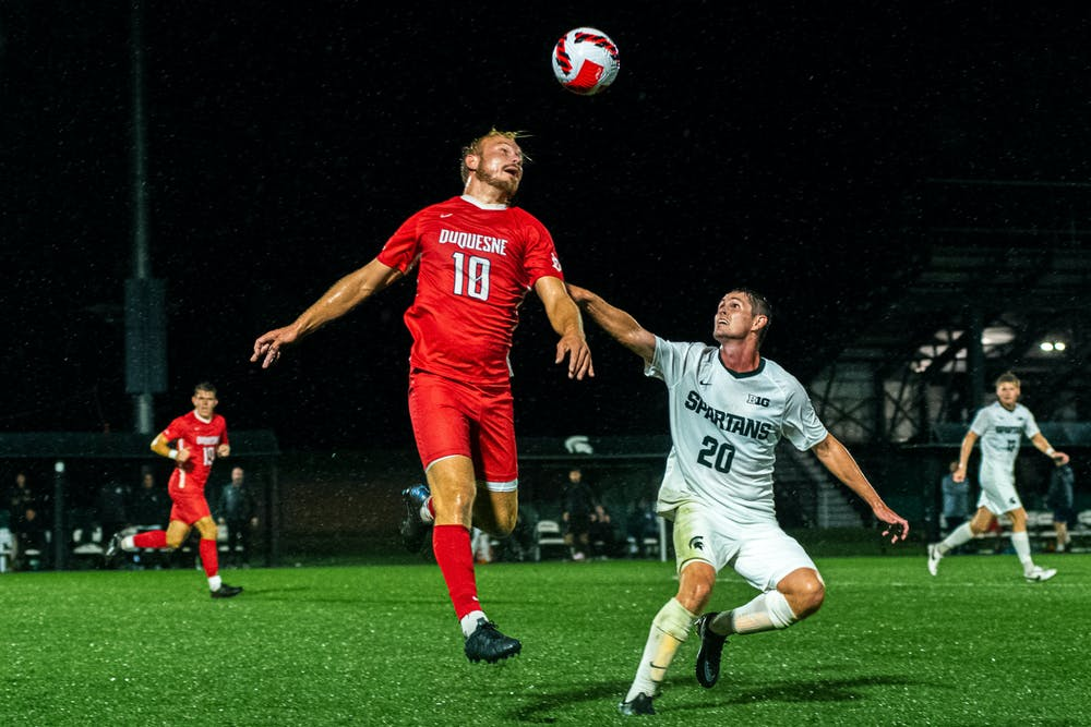 <p>Duquesne freshman forward Joey Belloti intercepts the ball with a header. Michigan State men&#x27;s soccer team defeated Duquesne 1-0 on Sept. 21, 2021 in East Lansing.</p>