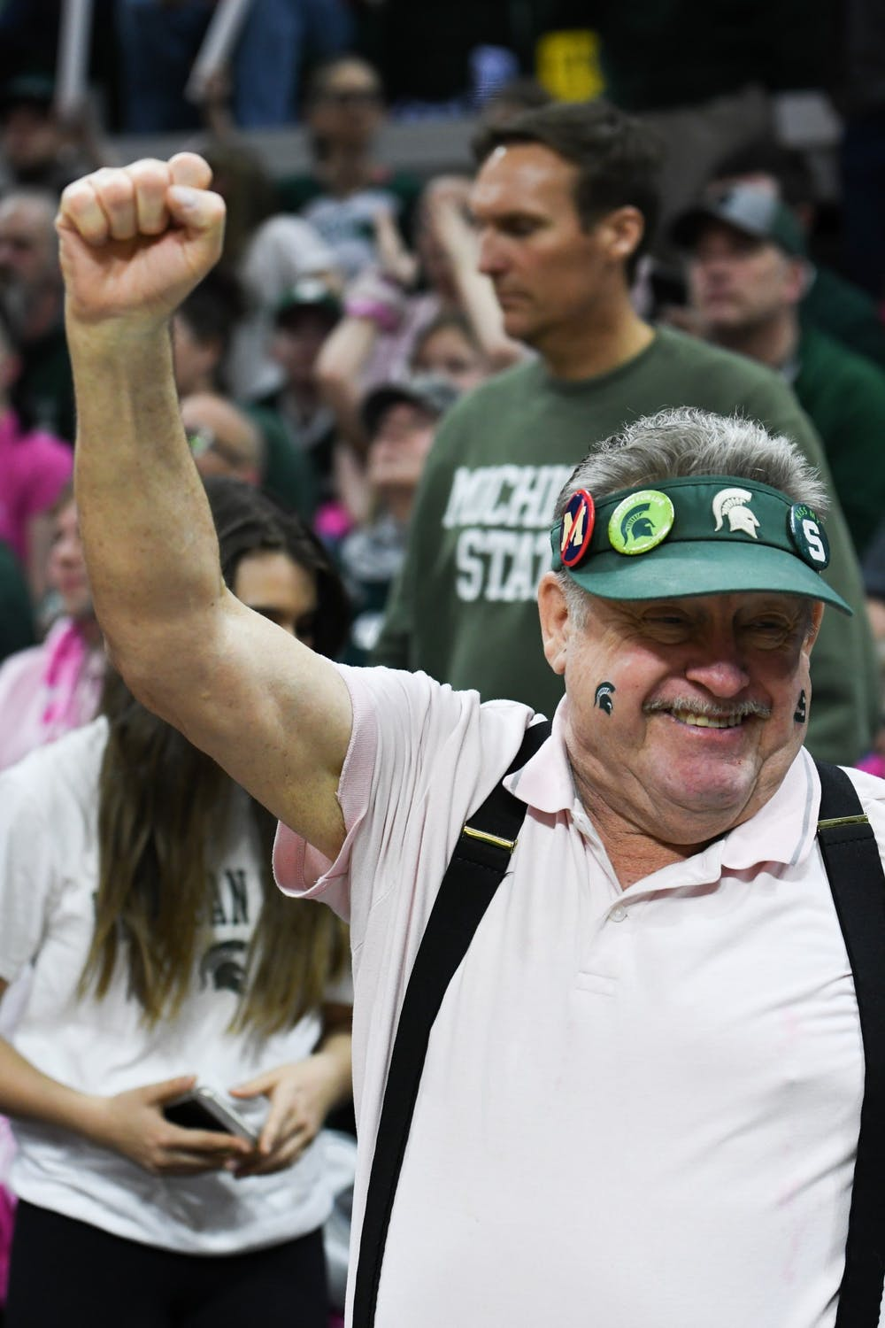 A spartan fan raises his fist in the air during the women's basketball game against Michigan at the Breslin Center on February 23, 2020. The Spartans fell to the Wolverines 65-57.