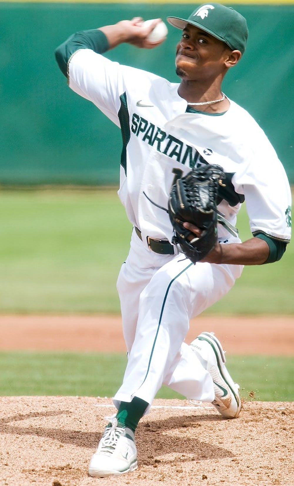 """<p>Then sophomore pitcher David Garner winds up for a pitch April, 22, 2012 at McLane Baseball Stadium at Old College Field. The Spartans beat the Gophers 5-4 in ten innings. The <span class=""""caps"""">MSU</span> baseball team kicks of the 2013 season Friday in South Carolina. State News File Photo</p>"""