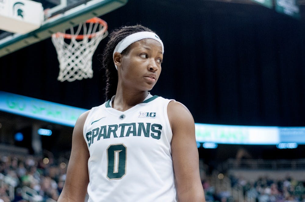 <p>Sophomore guard Kiana Johnson looks off to a teammate during the game against Penn State on Jan. 6, 2013, at Breslin Center. The Spartans lost to the Nittany Lions 76-55. Natalie Kolb/The State News</p>