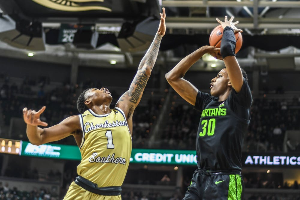 <p>Sophomore forward Marcus Bingham Jr. (30) shoots the ball during the game against the Charleston Southern Buccaneers at Breslin Center on Nov. 18, 2019. The Spartans defeated the Buccaneers, 94-46.</p>
