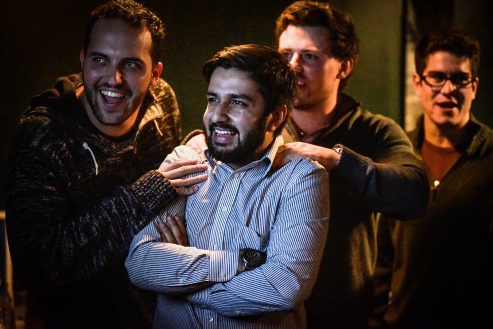 <p>Political science senior Aaron Stephens reacts to his incoming votes for East Lansing City Council on Nov. 7, 2017 at Hopcat.&nbsp;</p>
