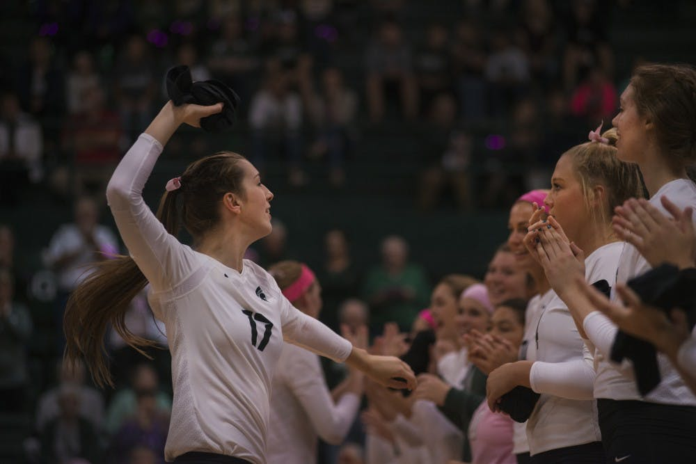 Junior middle blocker Alyssa Graveling (17) throws a t-shirt to the crowed after being introduced on the court before the game against Rutgers on Oct. 19, 2016 at Jenison Fieldhouse The Spartans defeated the Scarlet Knights, 2-1.