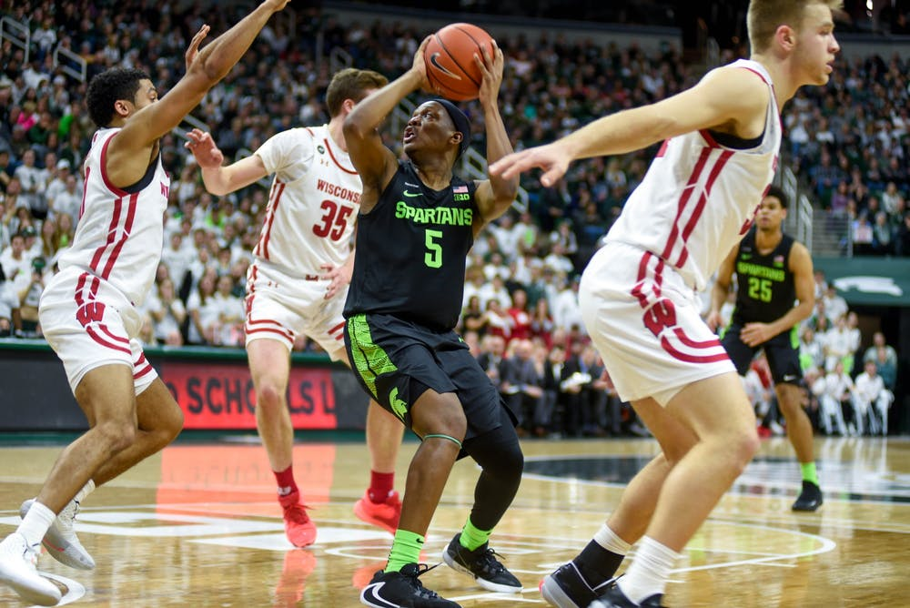 <p>Senior guard Cassius Winston (5) shoots the ball during the game against Wisconsin on Jan. 17, 2020 at Breslin Center. The Spartans defeated the Badgers, 67-55.</p>