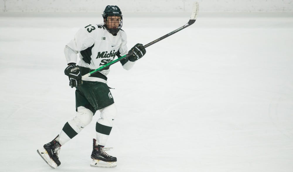 <p>Senior left wing Brennan Sanford (13) skates during the game against Ohio State University at Munn Ice Arena Jan. 5, 2019. The Spartans fell to the Buckeyes, 6-0.</p>
