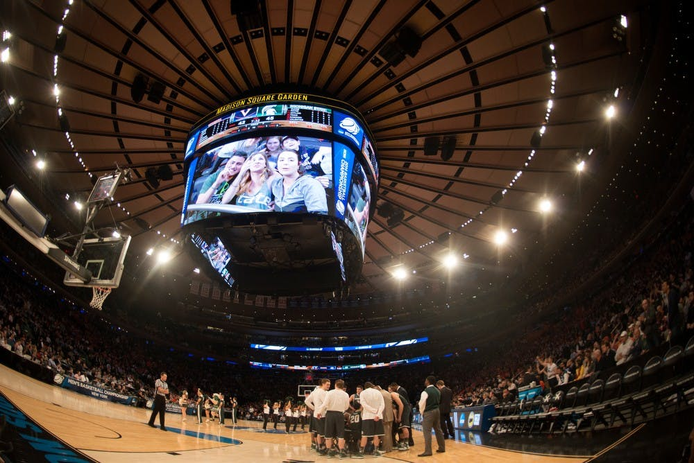 <p>The Spartans huddle during a timeout March 28, 2014 during the game against Virginia at Madison Square Garden in New York City during the NCAA tournament. The Spartans won, 61-59. Julia Nagy/The State News</p>