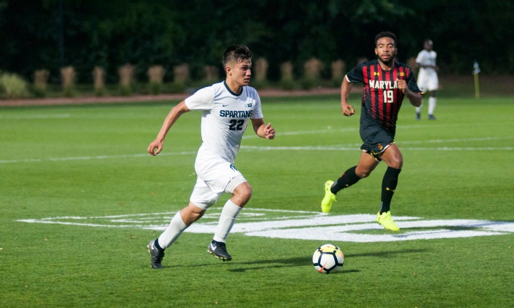 Senior midfielder Ken Krolicki (22) dribbles the ball upfield on Sept. 22, at DeMartin Stadium at Old College Field. The Spartans and the Terrapins tied in a 0-0 draw in 2OT.