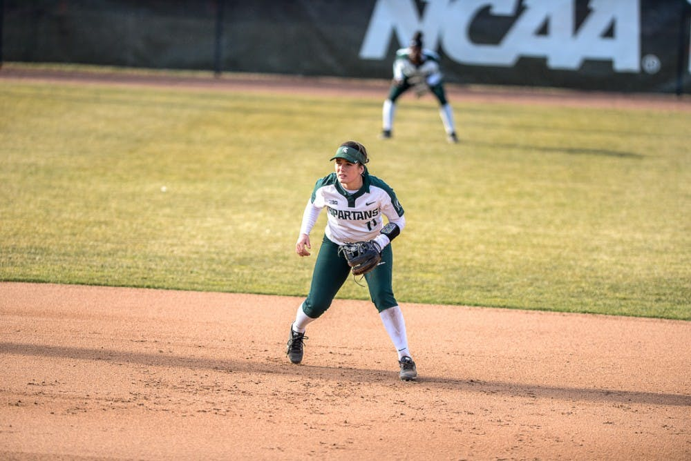 <p>Sophomore shortstop Caitie Ladd (11) scans the field during the game against Oakland on April,3, 2019 at Secchia Stadium. The Spartans beat the Golden Grizzlies,  11-3. </p>