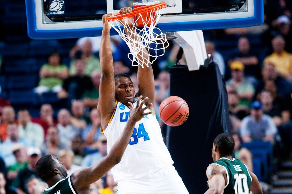 <p>UCLA center Joshua Smith dunks over then-junior forwards Draymond Green and Delvon Roe in the second half. The Spartans lost to UCLA, 78-76, in the second round of the NCAA Tournament on March 18, 2011, at St. Pete Times Forum in Tampa, Florida. </p>