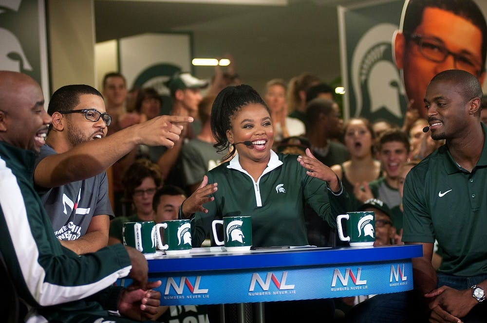 """<p>From left to right, former MSU basketball player Mateen Cleaves, ESPN's Michael Smith, MSU alumna and former State News reporter ESPN's Jemele Hill and former MSU football player Plaxico Burress tape ESPN2's """"Numbers Never Lie"""" on Sept. 26, 2014, at the Union. Raymond Williams/The State News</p>"""