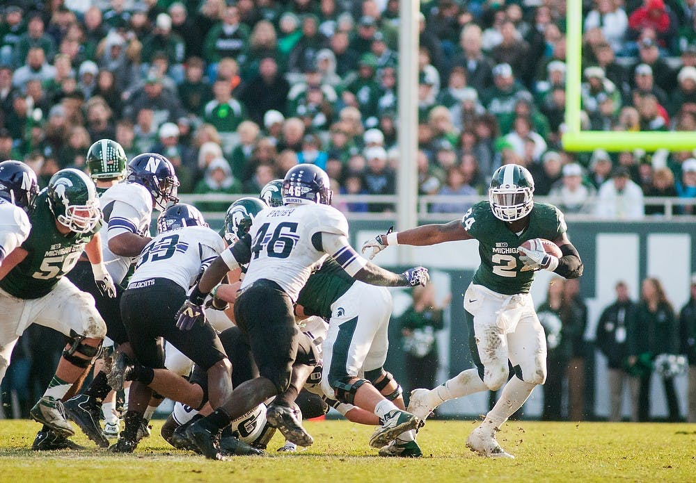 <p>Junior running back Le&#8217;Veon Bell escapes Northwestern&#8217;s defenders on Saturday, Nov. 17, 2012, at Spartan Stadium. Bell contributed 133 rushing yards in the Spartans&#8217; 23-20 loss to Northwestern. James Ristau/The State News</p>