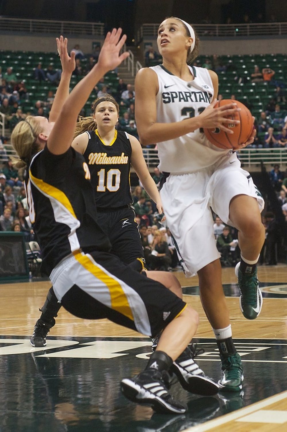 <p>Junior guard Klarissa Bell is called for a charge on Wisconsin-Milwaukee forward Sami Tucker on Saturday, Dec. 1, 2012, at Breslin Center. The Spartans defeated Wisconsin-Milwaukee, 81-50, improving their overall record to 7-0. Adam Toolin/The State News</p>