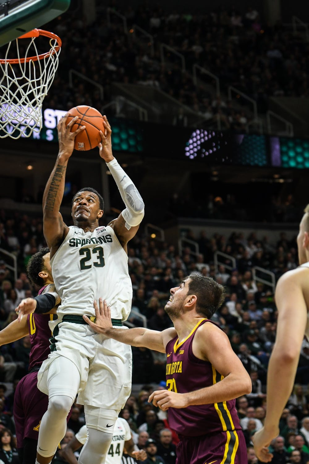 <p>Junior forward Xavier Tillman (23) makes a layup during the game against Minnesota at the Breslin Center on Jan. 9, 2020. The Spartans defeated the Golden Gophers 74-58.</p>