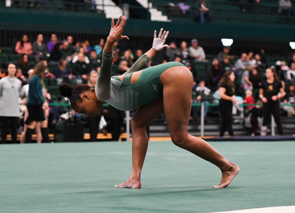 <p>Freshman Nyah Smith during her floor routine at the gymnastics meet at Jenison Field House on Feb. 16, 2020. The Spartans took the win over the Fighting Illini. </p>