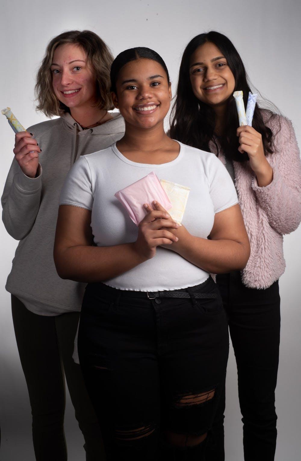 <p>Emily Estrada, left, and Ta'Sheena Williams, center, and Nama Naseem, left, pose for a photo on Feb. 5, 2019.</p>