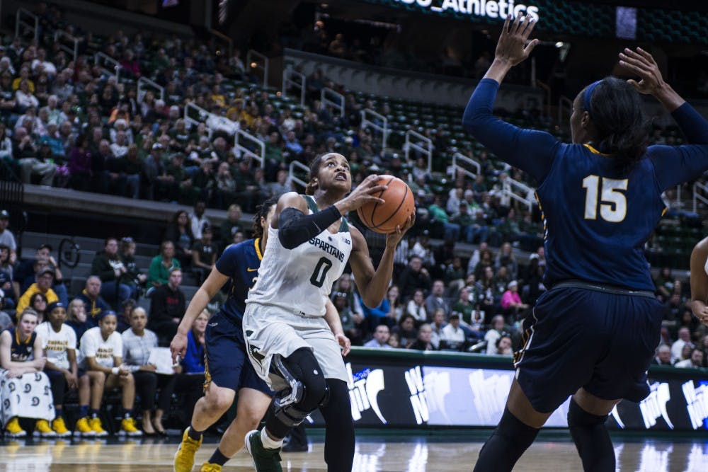 Redshirt sophomore guard Shay Colley (0) goes up for a lay up during the second round of the Women's National Invitation Tournament against Toledo on March 19, 2018 at Breslin Center. The Spartans defeated the Rockets, 68-66. (C.J. Weiss | The State News)