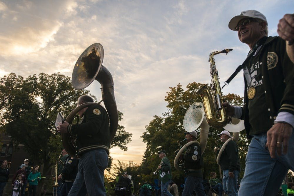 Spartan marching band alumni walk during the homecoming parade on Oct. 14, 2016 on Abbot Road.
