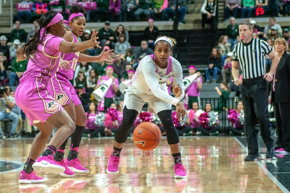 Redshirt-junior guard Shay Colley (0) passes the ball during the women's basketball game against Purdue at Breslin Center on Feb. 3, 2019. The Spartans defeated the Boilmakers 74-66.