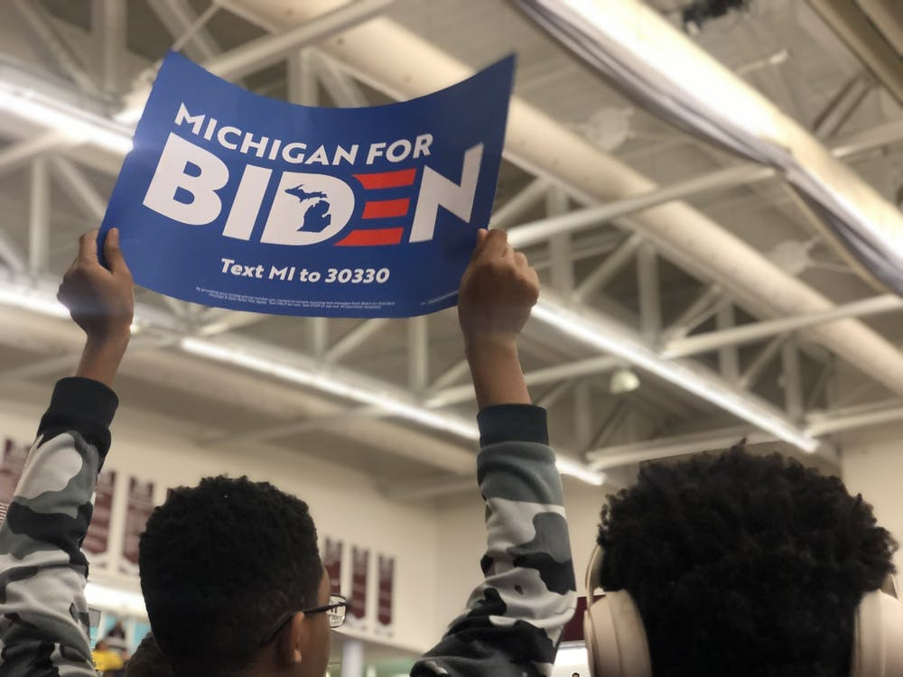 <p>A supporter of former vice president and presidential candidate Joe Biden&#x27;s campaign holds a sign at an event in Detroit.</p>