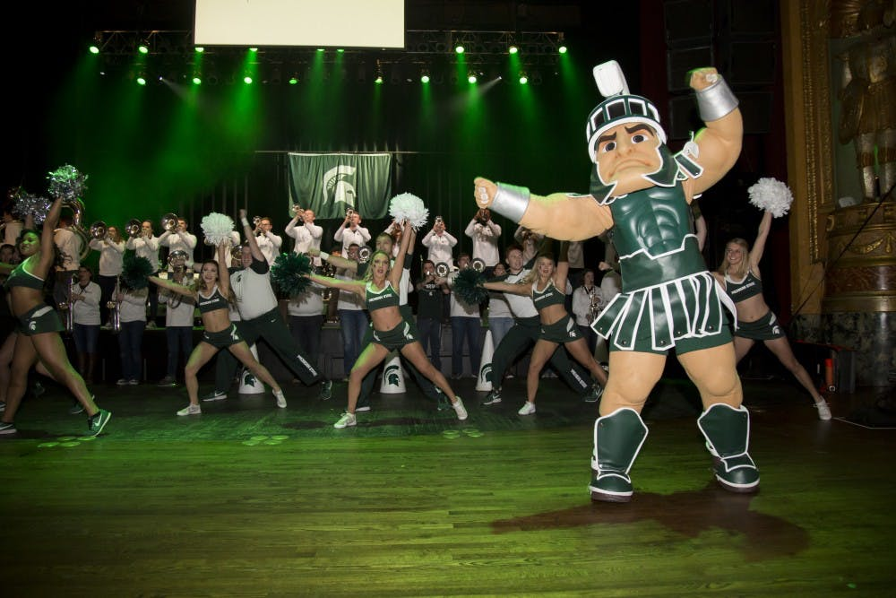 <p>Sparty dances along with the Spartan Brass and the MSU Cheer and Dance team as they perform the MSU fight song during the 2018 NCAA Spartan Pep Rally at The Fillmore in Detroit on March 16, 2018</p>