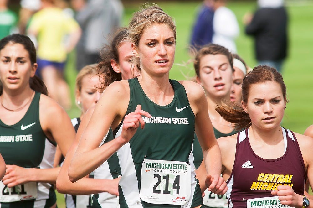 <p>Redshirt freshman runner Rachele Schulist runs during the Spartan Invitational on Sept. 12, 2014, at Forest Akers East Golf Course, 2280 South Harrison Road, in East Lansing, Mich. Schulist placed second with a time of 21:05. Raymond Williams/The State News</p>
