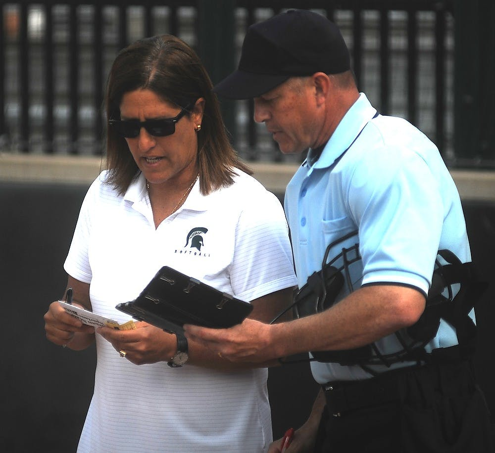 <p>MSU softball head coach Jacquie Joseph talks with the referee April 17, 2015, during a game against Minnesota at Secchia Softball Stadium. The Spartans were defeated by the Golden Gophers, 8-4. Alice Kole/The State News</p>