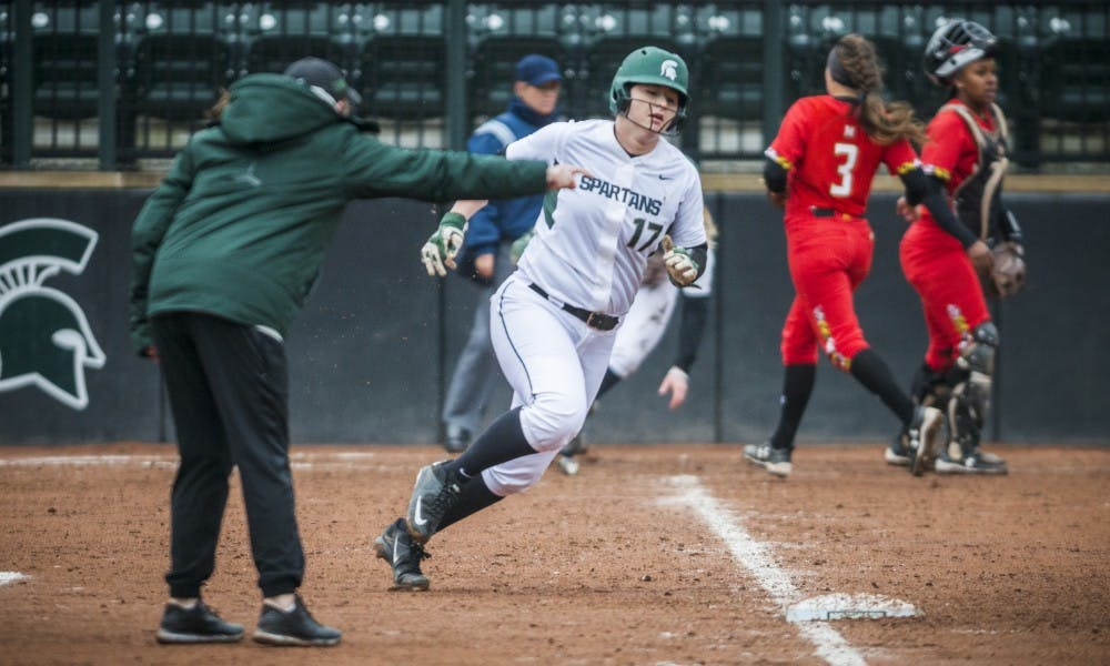 Freshman catcher and third baseman Kelcey Carrasco (17) rounds first base during the game against Maryland on March 31, 2017 at Secchia Stadium. The Spartans defeated the Terrapins, 11-3.