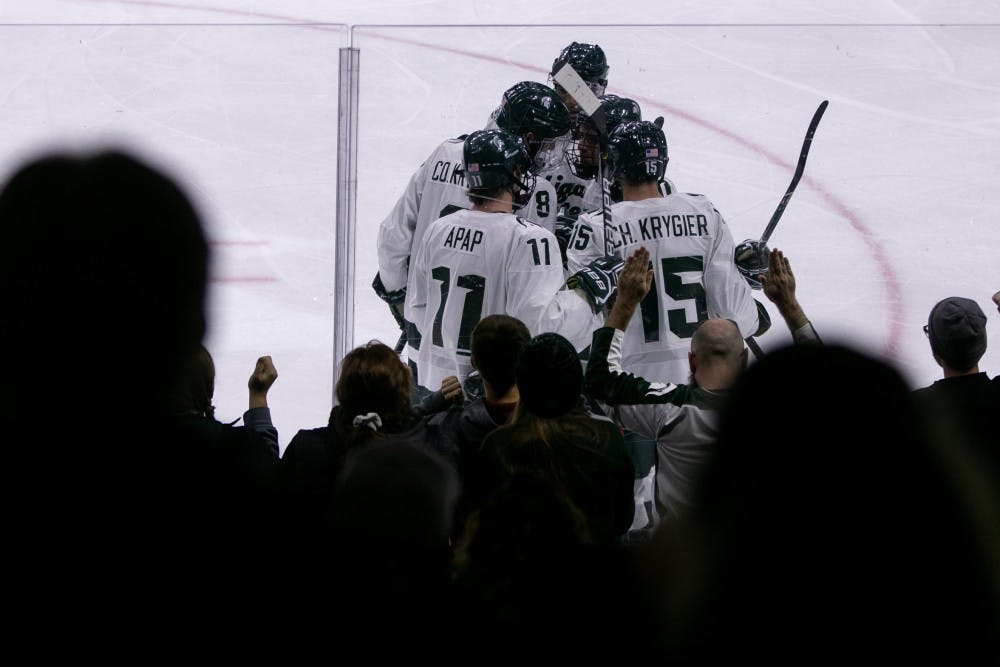 <p>The Spartans celebrate a goal during the game against Western Ontario at Munn Ice Arena Oct. 7, 2019. The Spartans defeated the Mustangs, 6-1.</p>